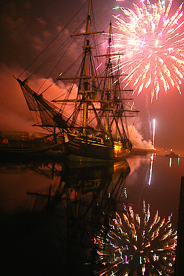 "Fireworks reflect off the waters of Pickering Wharf in Salem, MA while the ""Friendship"" takes it all in."